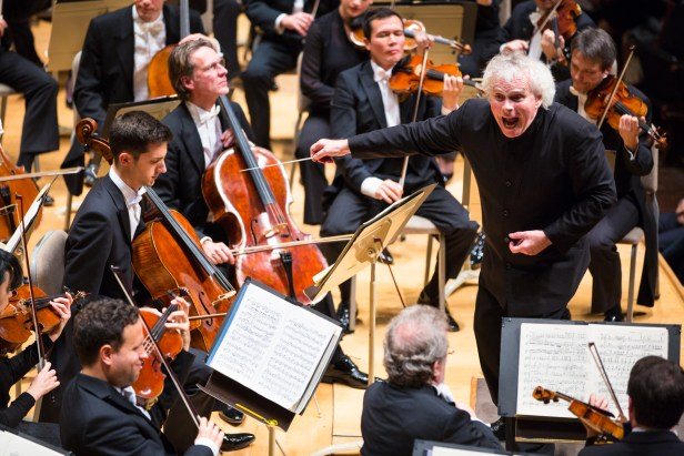 Sir Simon Rattle conducts the Berlin Philharmonic at Symphony Hall. Photo Robert Torres.