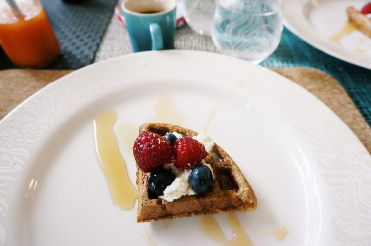 Honey Oat Waffle with Fresh Whipped Cream, Maple Syrup and Berries