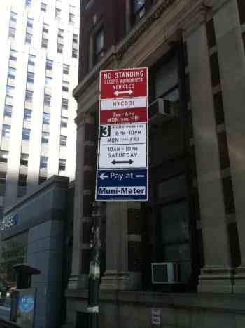 NYC parking signs on a gotcha pole