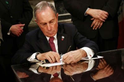 Mayor Bloomberg signing parking sign bill