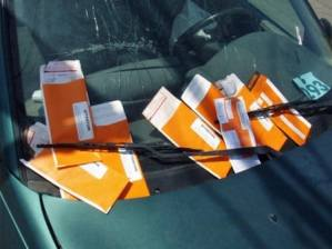 This image shows many parking ticket under a wiper to indicate that a car can be issued many parking tickets while parked
