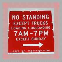parking sign_except trucks loading and unloading