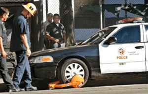 This image is a boot attached to the wheel of a police car