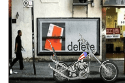 This is an image of a motorcycle parked in front of a parking sign