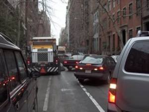 This image shows what happens on street cleaning days when the sweeper passes in a NYC neighborhood