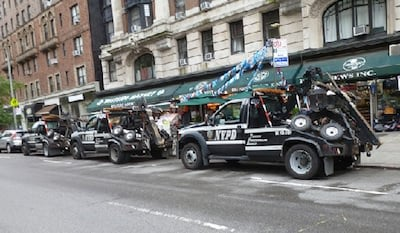 This image is three police tow trucks ready to tow unsuspecting members of the NYC driving public