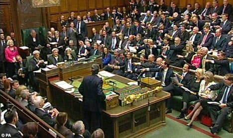 This image is a hearing in the British House of Commons likened to a hearing at NYC Council