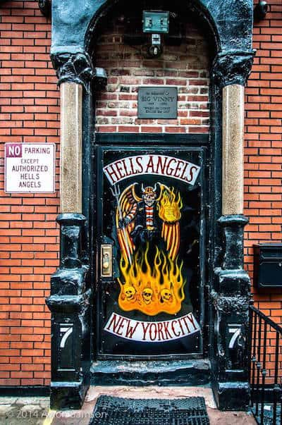 This image is a Hell's Angels door with a no parking authorized vehicles only sign