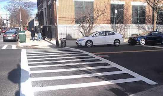 crosswalk-stop line-parked car between stop line and crosswalk