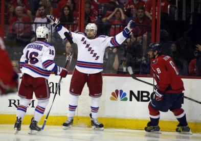 Finally, Rick Nash celebrates his first goal of the series with teammate Derick Brassard. Game 7 is Wednesday at MSG. AP Photo by Alex Brandon/Getty Images