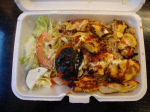Chicken kebab over rice