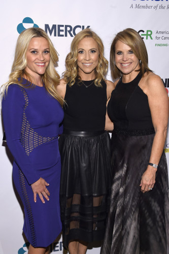 """NEW YORK, NEW YORK - APRIL 09: (L-R) Reese Witherspoon, Sheryl Crow and Katie Couric attend Stand Up To Cancer's New York Standing Room Only, presented by Entertainment Industry Foundation, with donors American Airlines and Merck, chaired by Jim Toth, Reese Witherspoon & MasterCard President/CEO Ajay Banga and his wife Ritu, honoring Katie Couric at Cipriani Wall Street on April 9, 2016 in New York City. (Photo by Dimitrios Kambouris/Getty Images for EIF)"""