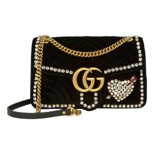 Black Gucci handbag with crystal details and gold chain strap