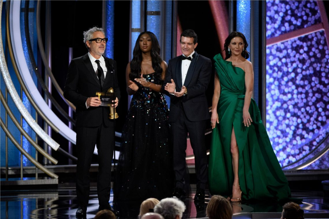 "Accepting the Golden Globe for BEST MOTION PICTURE – FOREIGN LANGUAGE for ""Roma"" (MEXICO) is Alfonso Curaon from presenters, Antonio Banderas and Catherine Zeta-Jones at the 76th Annual Golden Globe Awards at the Beverly Hilton in Beverly Hills, CA on Sunday, January 6, 2019."