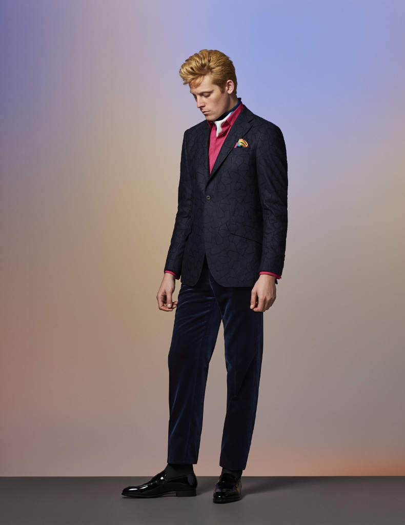 Blue/black modular flannel wool blend jacket with hot pink Swiss poplin pleat-front cotton shirt, midnight lux velvet trousers, pink neck and pocket silk squares and black patent leather Walton slip-ons.