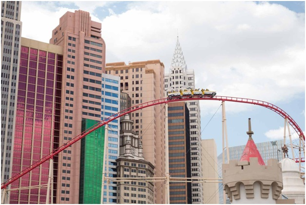 A roller coaster traveling over the New York New York Hotel & Casino