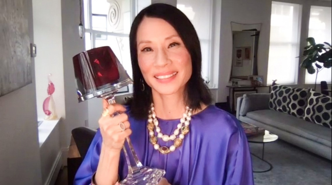 Lucy Liu holding Trophy