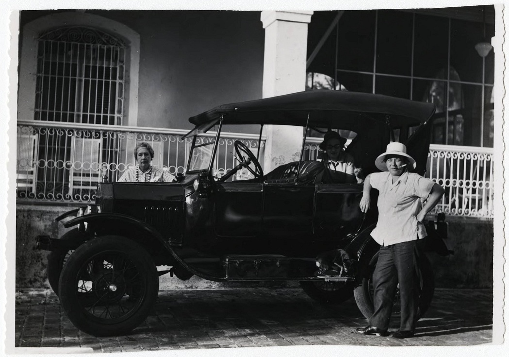 Lydia Cabrera (behind the car) and Josefina Tarafa (standing in front of the car), ca. 1957. Courtesy Cuban Heritage Collection, University of Miami