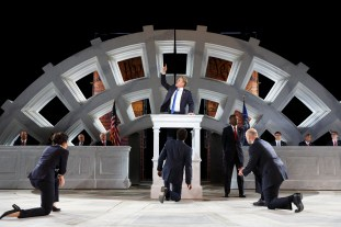 Gregg Henry (center) and the company in The Public Theater's Free Shakespeare in the Park production of Julius Caesar
