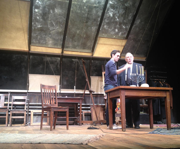 "Ari Brand, the star of ""My Name is Asher Lev,"" lights Hanukah candles on the stage (not part of the show.)"