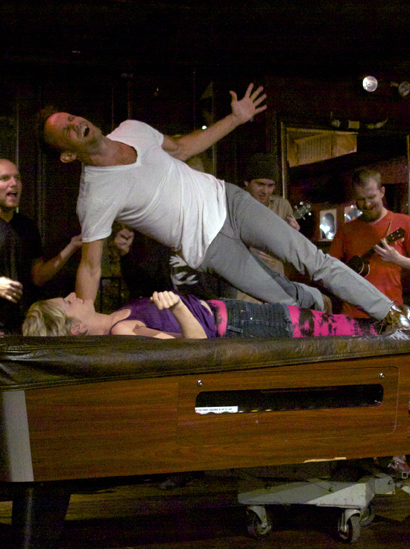 Romeo atop Juliet atop a pool table in Three Day Hangover's production of Romeo and Juliet -- one of three this season