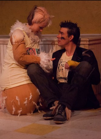 """Has there ever before been such a touching love scene between poultry? In The Year of the Rooster, by Eric Dufault, a young rooster named Odysseus Rex, played by Bobby Moreno like an angry punk with a knife, is introduced to Lucky Lady (Megan Tusing), a hen genetically engineered by McDonald's to be twice her normal weight, and so virtually unable to stand. At first they don't get along. He's all…well…cocky. She behaves in a way that explains where the phrase """"hen-pecked"""" comes from. But swiftly she is able to reach inside his chest and remove the anger he says is there, shaped like an anvil. They kiss, like the French (like birds!), cheek to cheek, and snuggle."""