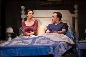 """Marin Hinkle and Jeremy Shamos play a married couple who learn their best friends are divorcing in """"Dinner With Friends."""" There is a scene (not this one) in which they talk about their fears about their own marriage while they prepare for bed, folding a bedspread in perfect unison like some kind of two-man Olympic team, so practiced in the act that they are unaware of it."""