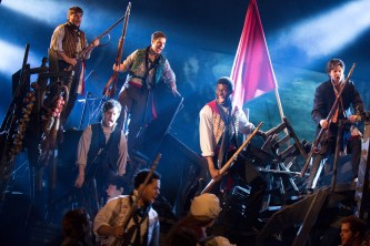 Les Miz Kyle Scatliffe as Enjolras waving the flag