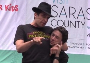 Zach Braff and Nick Cordero perform from Bullets Over Broadway in Bryant Park shortly before the show closes on Broadway