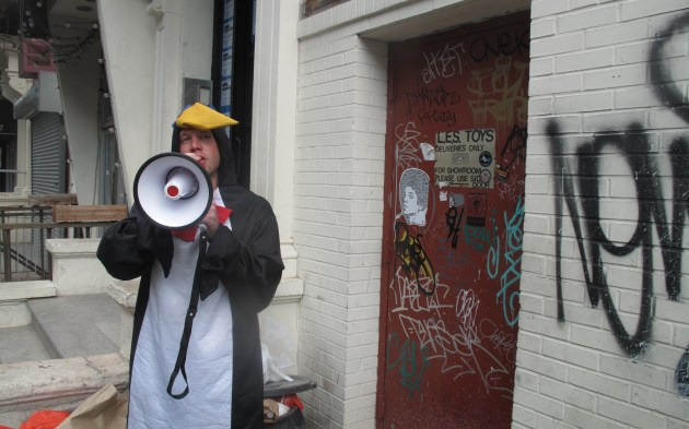 Xavier Toby as a penguin giving a tour of NYC 100 years from now.