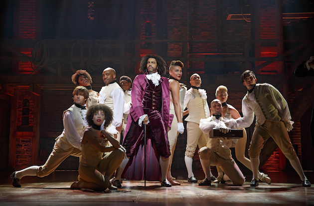 Daveed Diggs as Thomas Jefferson with ensemble of Hamilton