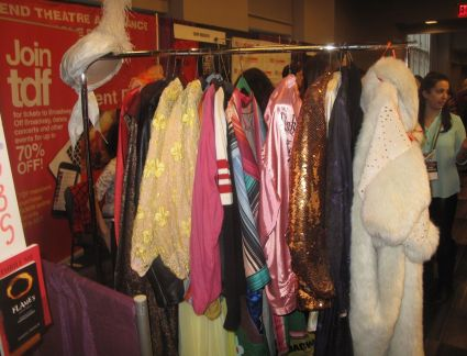 The costume collection at the TDF booth, one of many at BroadwayCon.