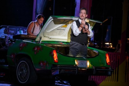 Songwriter Shaina Taub playing the keyboards in the back seat, and Andrew Kober as Malvolio in the car trunk