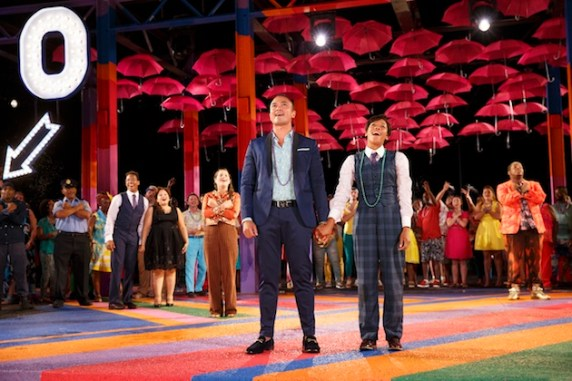 Jose Llana, Nicki M. James, some of the 200 other cast members, and lots of pink umbrellas in the Public Works' Twelfth Night.