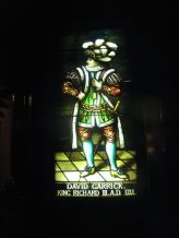 stained glass portrait of 18th Century English actor David Garrick. The Garrick Club in London gave Edwin Booth the idea for The Players Club.