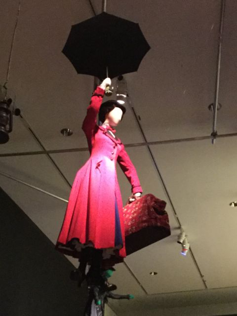 Mary Poppins costume suspended from the ceiling