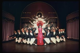 """Ethel Merman and waiters in a scene from the Broadway production of the musical """"Hello, Dolly!""""."""