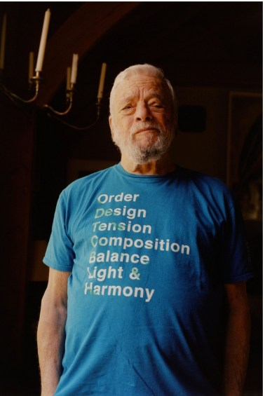 "Stephen Sondheim, wearing a t-shirt with a line from his ""Sunday in the Park with George"""