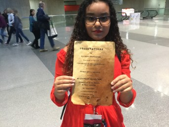 Young attendee at BroadwayCon dressed as Eliza Hamilton, with the parchment to prove it.