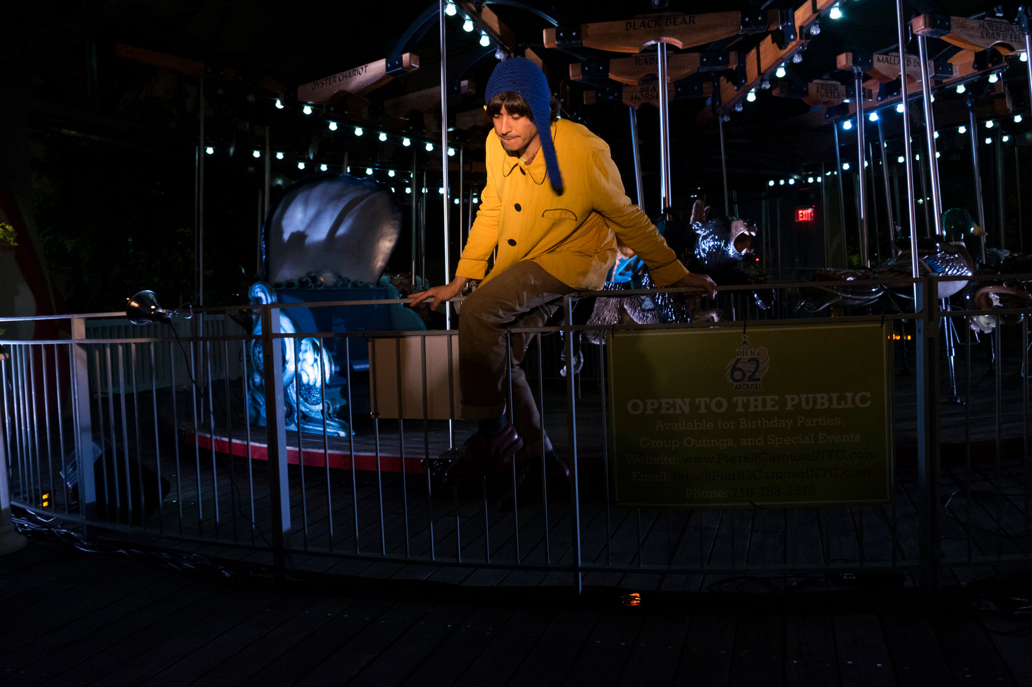 """BOSSS 2015 ulian Koster, who played a musical saw, starred in """"Night, Janitor, Carousel,"""" set at the carousel at Pier 62. part of Big Outdoor Site-Specific Stuff, or BOSSS"""