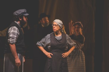 "Jackie Hoffman, in the Yiddish Fiddler on the Roof: Avrom, I have a golden match [ ""a goldenem shidukh""] for your son, a girl, a diamond. Who is she? Rokhl, the shoemaker's daughter. Rokhl? She can barely see. She's almost entirely blind. The truth is, Avrom, what is there to see in your son? The way she sees, and the way he looks— it's a match from heaven. All this was accompanied by English subtitles, but the Yiddish was not just as musical as the songs. In a single instant, the exchange revealed the source of much of American comedy -- the shrug and the whine and the wisecrack -- as derived from the rhythm of the Yiddish language."