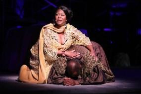 Greta Oglesby as Antigone, and Rev Earl Miller as The Messenger