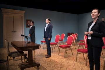 "The set of ""Intractable Woman"" is a re-creation of a Russian press room, complete with a picture of Russian President Vladimir Putin on the wall."