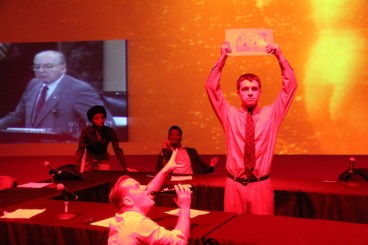 A scene from THE AЯTS. L to R is Shayna Conde, Dracyn Blount, Nick Daly (foreground), and Alex Chilton (standing).Senator Jesse Helms (R-North Carolina), an arts opponent, in the video
