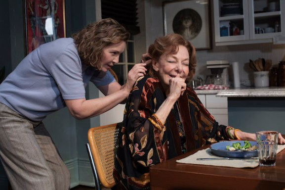 Joan Allen as Ellen fixing the hearing aid of her mother Gladys, portrayed by Elaine May, in The Waverly Gallery
