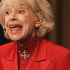Carol Channing in red