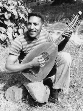Late 1940s photo of Rustin with lute. Courtesy Estate of Bayard Rustin