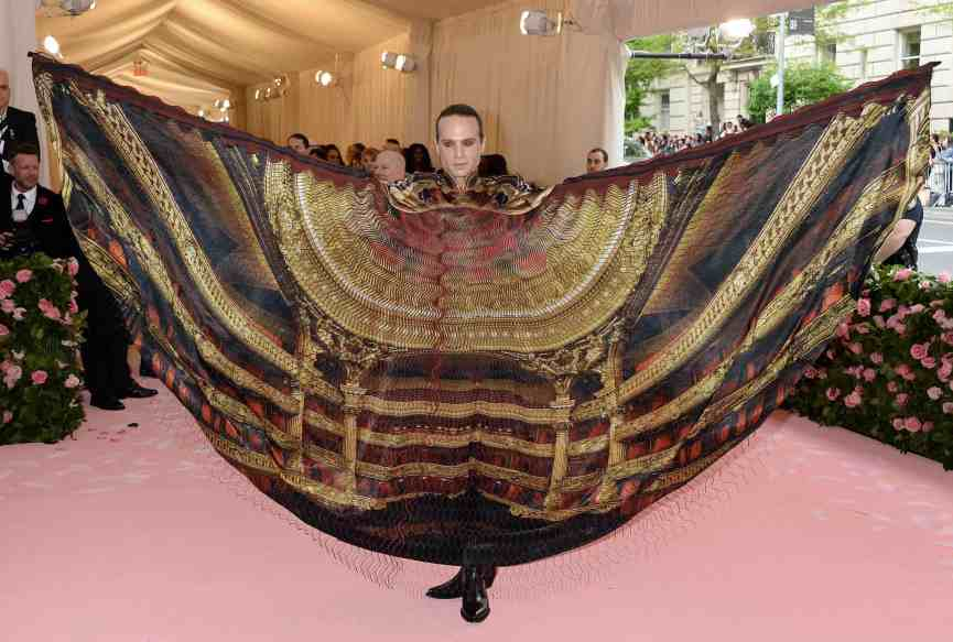 Jordan Roth, president of Jujamcyn Theaters, in an Iris van Herpen cape, depicting the interior of an opera-house
