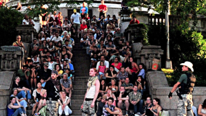 Audiences sitting on the steps of Riverside Park's Soldiers and Sailors Monument