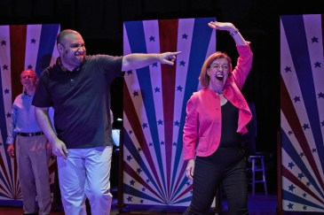 "Madison Ray as Cory Booker and Mary Bricker as Elizabeth Warren in ""Adore Us! Line"""